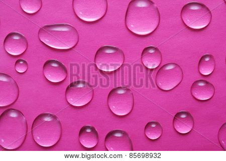 E Drops Of Water On A Pink Background