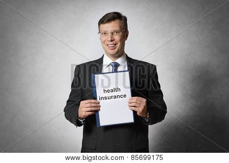 Business Man With Health Insurance