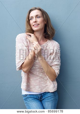 Happy Mid Adult Woman In Jeans And Sweater