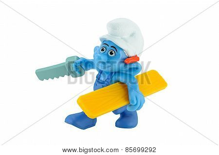 Smurfs Handy Carpenter With Saw And A Bit Of Wood.
