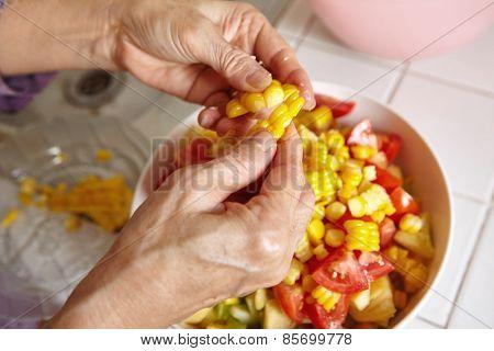 Preparing fresh vegetables for salad