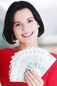 picture of zloty  - Cheerful young lady holding cash  - JPG
