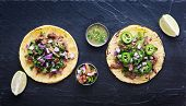stock photo of tacos  - top down photo of two authentic mexican tacos - JPG