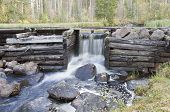 image of water-mill  - A water power construction made of wooden logs - JPG