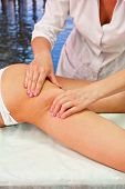 pic of cellulite  - Legs and buttocks woman massage to reduce cellulite - JPG