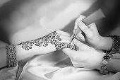 image of mehndi  - Process of applying Mehndi on female hand - JPG