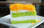 pic of dessert plate  - Thai dessert Foythong Cake or Gold Egg Yolks Thread Cake is a dessert of Thailand Made from egg placed on pandan cake - JPG