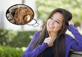 stock photo of nest-egg  - Pensive Woman with Money and Golden Nest Egg Inside Thought Bubble - JPG