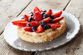 stock photo of custard  - Delicious homemade tartlet with custard and berries - JPG