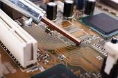 picture of rework  - Repairing of computer motherboard - JPG