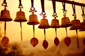 picture of nepali  - Nepaly traditional Bells over the sun at sunset - JPG