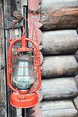 stock photo of kerosene lamp  - Kerosene lamp on wooden door background - JPG