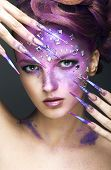 picture of long nails  - Girl with bright purple creative makeup with crystals and long nails - JPG