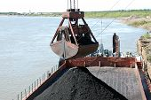 stock photo of coal barge  - Slackline cableway bucket with coal at river port Russia - JPG