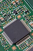 picture of microchips  - Macro shot of a circuit board with microchip in high detail - JPG