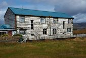 stock photo of falklands  - Weathered farm house on the coast at Port San Carlos in the Falkland Islands - JPG