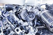 pic of motor vehicles  - Disassembled shiny metal powerfull motor of sports vehicle in workshop service - JPG