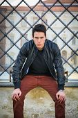 picture of turin  - Handsome young man outside historical building in European city  - JPG