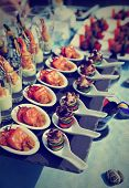stock photo of banquet  - Spoons with seafood snacks  - JPG