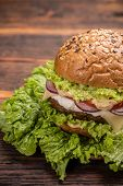 pic of beef-burger  - Burger stacked with a beef patty cheese fresh lettuce onion and tomato - JPG