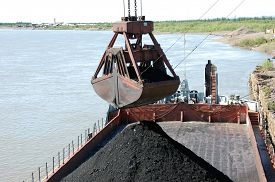 pic of coal barge  - Slackline cableway bucket with coal at river port Russia - JPG