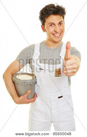 Smiling painter with paint bucket holding his thumb up