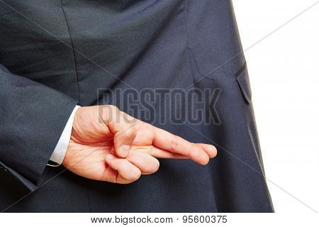 Fingers of a hand of a business man crossed behind his back