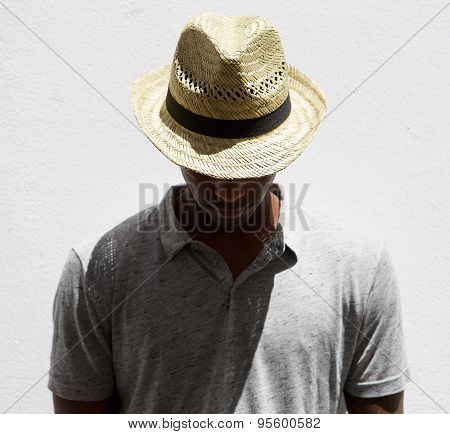 Male Fashion Model With Hat Looking Down