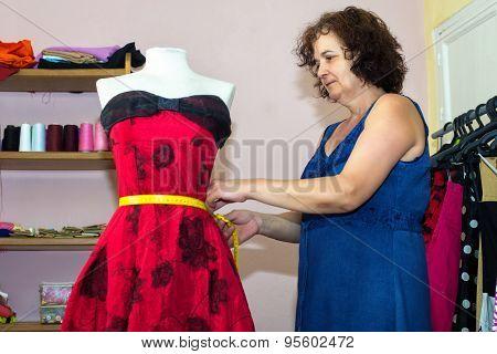 Seamstress Doing Arrangements In A Dress