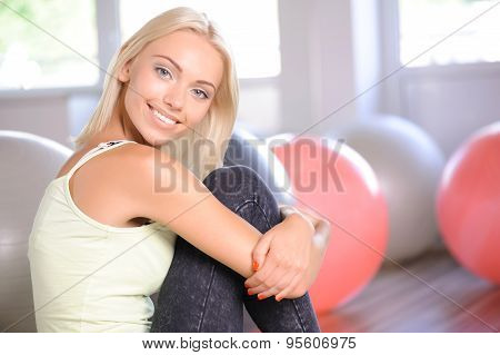 Blond girl with a fitness ball