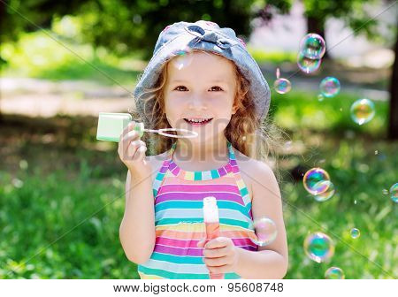 Todddler Happy Girl Blowing Soap Bubbles