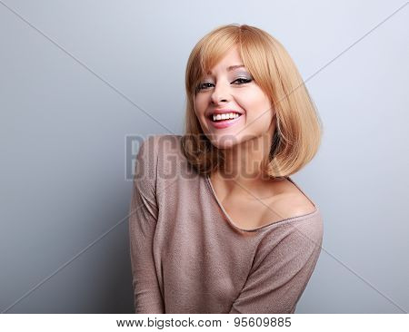 Happy Young Blonde Woman In Fashion Blouse Laughing
