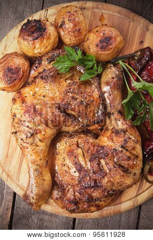 Roasted chicken legs with oven baked potatoes, classic of traditional cuisine