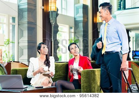 Business people greeting each other in a hotel