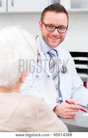 Doctor seeing senior patient in practice