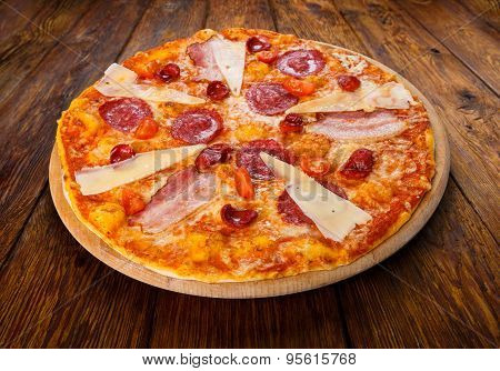 Delicious Italian Pizza With Salami, Bacon And Parmesan