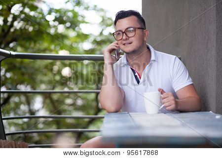 Man have phone conversation during coffee brake
