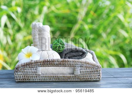 Spa still life on wooden table on river