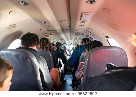 Passengers In Cramped Airplane Cabin