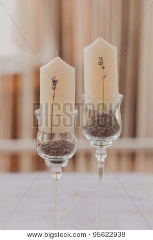 white wedding candles with beautiful lavanda flowers