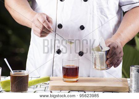 Pouring Milk To Tea