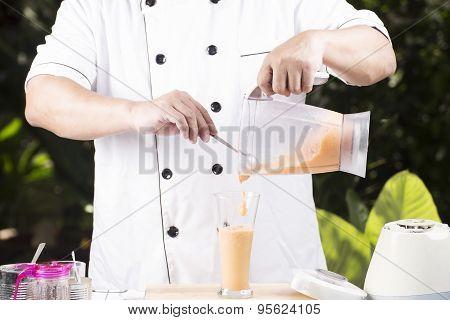 Chef Pouring Thai Tea Smoothie