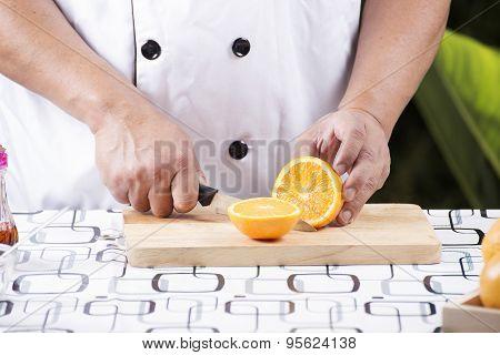 Chef Cutting Orange