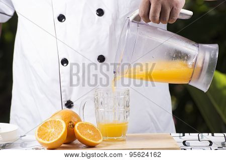 Pouring Orange Juice Smoothie To The Glass