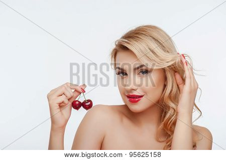 Attractive young girl with fresh appetite cherry