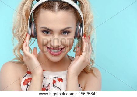 Attractive young woman is relaxing with earphones
