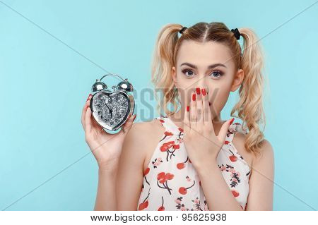 Cheerful young woman with interesting silver gift