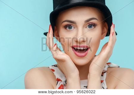 Beautiful young woman with black strange cap