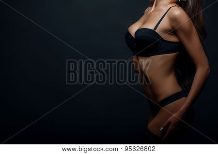 Attractive young woman is presenting her perfect body