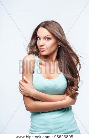 Pretty young woman is showing her surprise